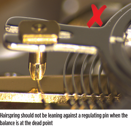 Hairspring should not be leaning against a regulating pin when the balance is at the dead point