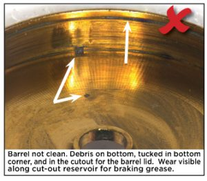 Barrel not clean. Debris on bottom, tucked in bottom corner, and in the cutout for the barrel lid. Wear visible along cut-out reservoir for braking grease.