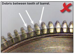 Debris between teeth of barrel.