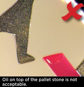 Oil on top of the pallet stone is not acceptable